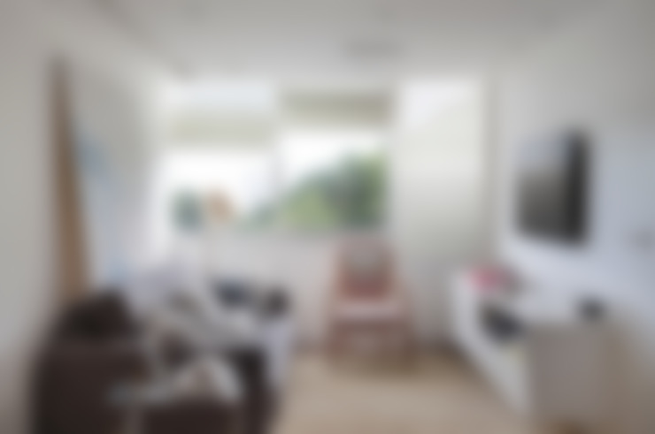 Apartamento 08: Salas de estar  por Estúdio Barino | Interiores