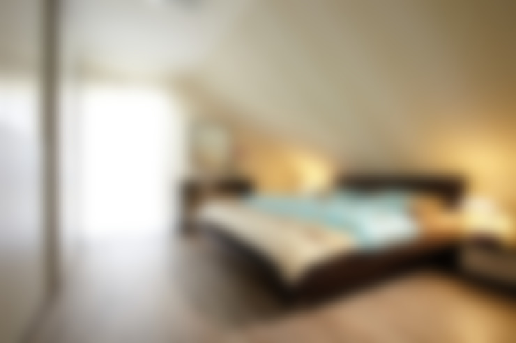 Dormitorios de estilo  de FingerHaus GmbH - Bauunternehmen in Frankenberg (Eder)