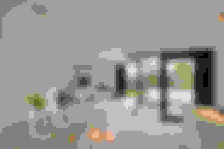Salas / recibidores de estilo  por CKX architecten