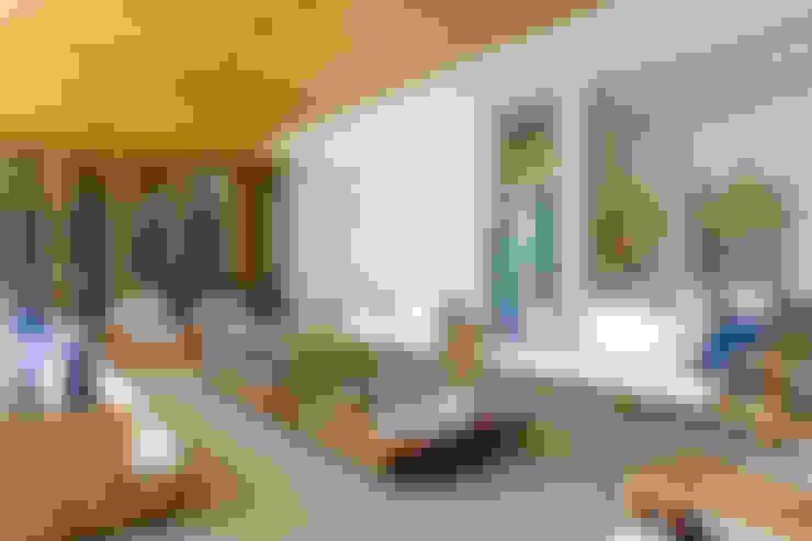 Casa Térrea: Salas de estar  por Ana Paula e Sanderson Arquitetura