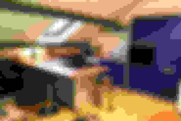 Rénovation d'un appartement: Cuisine de style  par AD2