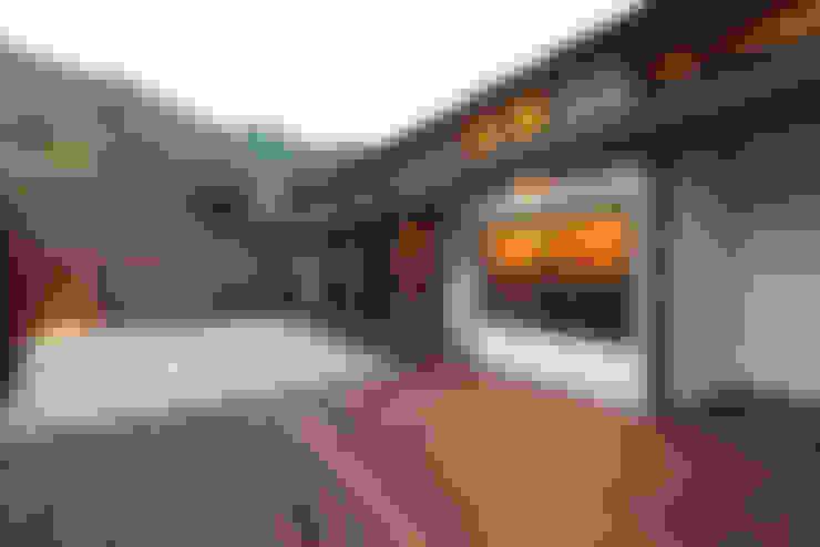 瀬戸田の離れ/古民家再生工事: 株式会社濱田昌範建築設計事務所が手掛けた庭です。