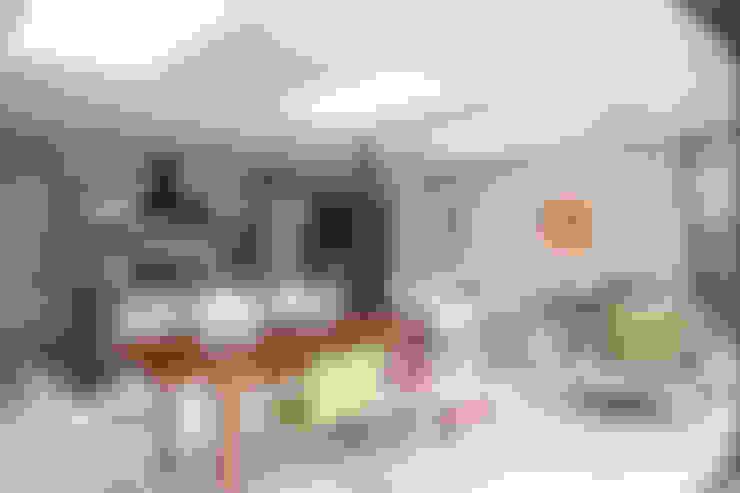 Dining room by Nic  Antony Architects Ltd