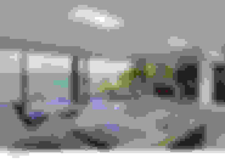 Livings de estilo  por The Manser Practice Architects + Designers