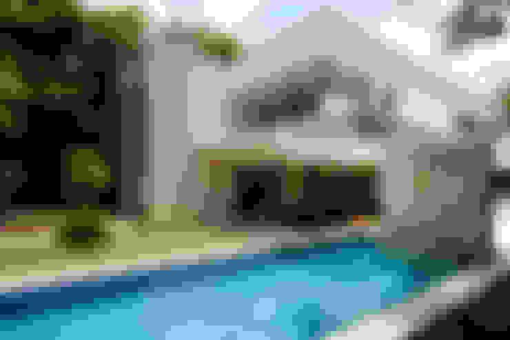 Piscinas de estilo  por Enrique Cabrera Arquitecto