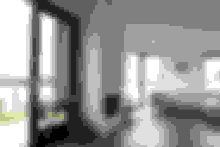 De woonkamer:  Woonkamer door OX architecten