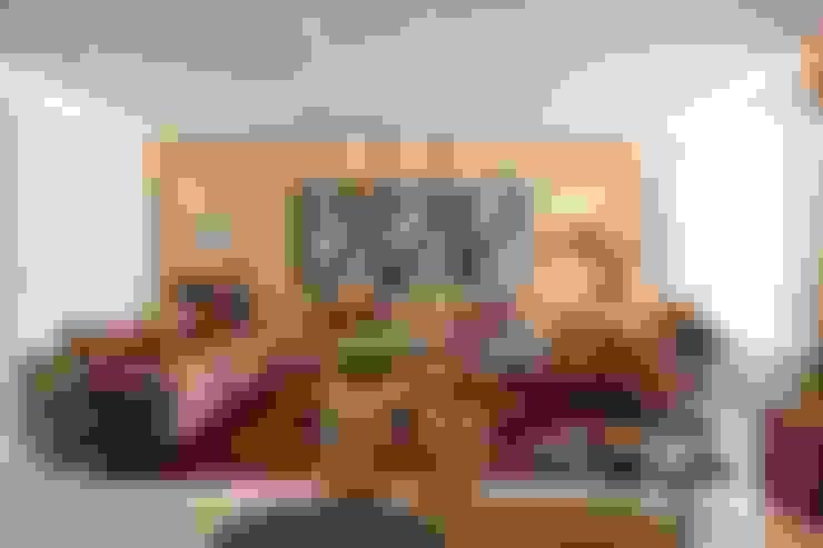 Apartamento CN: Salas de estar  por Gláucia Britto