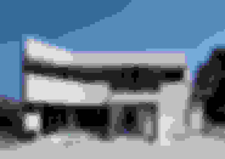 Casas de estilo  por atelier m