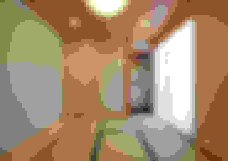 Salas multimedia de estilo  por atelier m