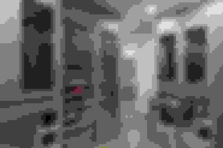 Closets de estilo  por HO arquitectura de interiores