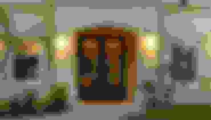 Puerta de entrada de hierro forjado Linea Clasica: Casas de estilo  por Del Hierro Design