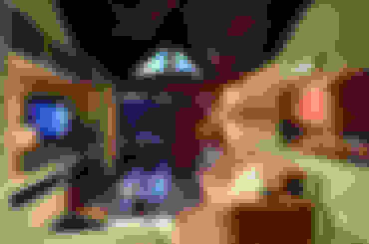 Estar íntimo: Salas de estar  por Stúdio Márcio Verza