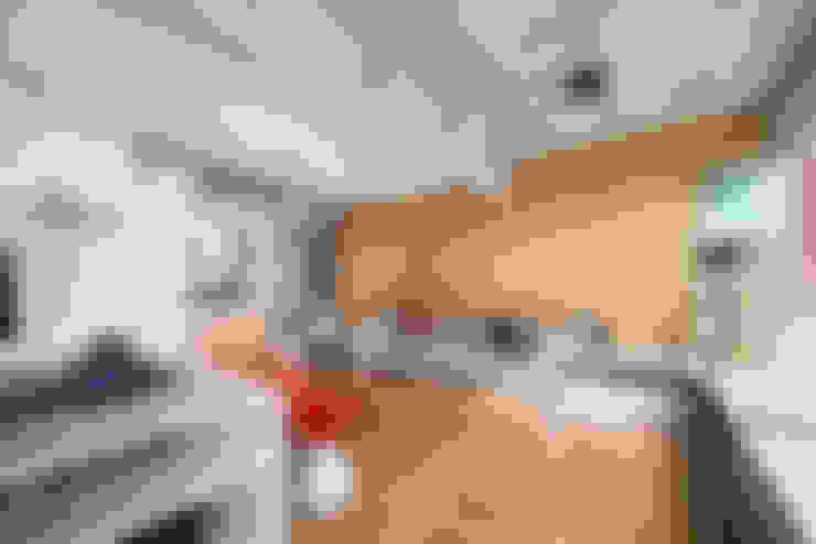 apto poledance: Salas de estar  por Casa100 Arquitetura