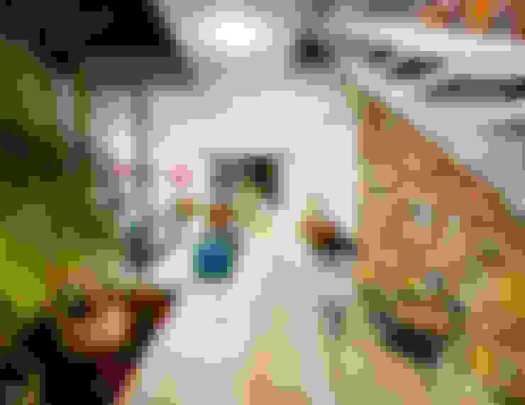 Corredores e halls de entrada  por HPONCE ARQUITECTOS