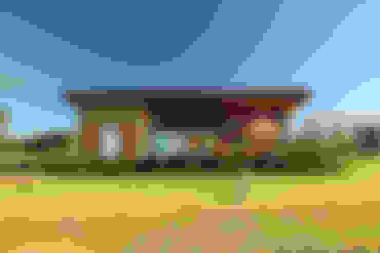 Casas  por Ambienta Arquitetura