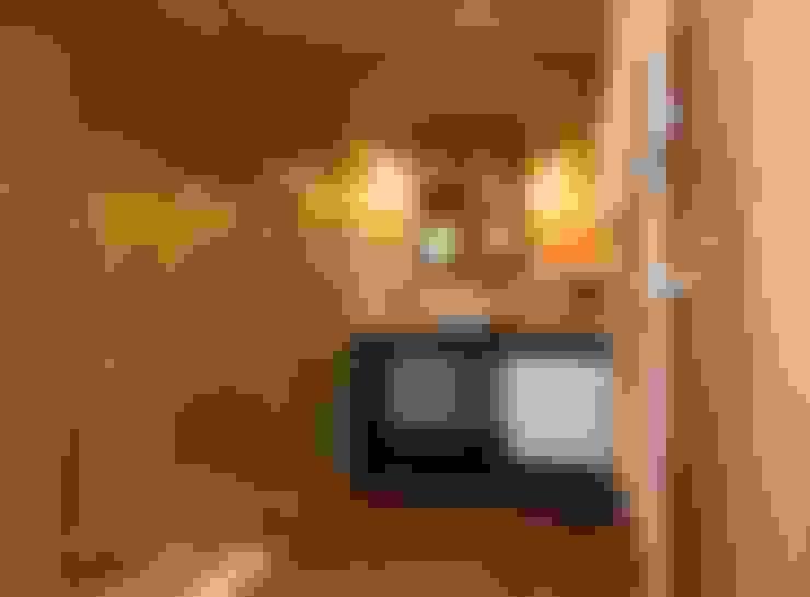 Baños de estilo  de Studio Luppichini