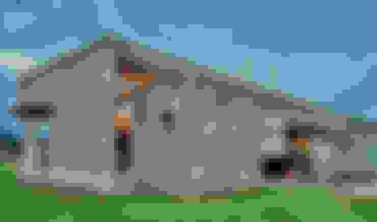 Exterior Casa el Tipal: Paredes de estilo  por Proyecto Norte