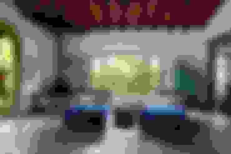 Sala de estar: Salas de estar  por Vida de Vila