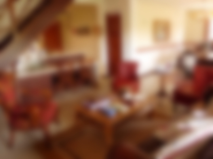 Sala da Lareira: Salas de estar  por Eveline Sampaio Arquiteta e Designer de Interiores
