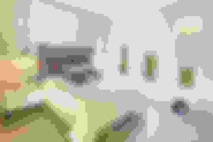 Dormitorios de estilo  por PORTO Arquitectura + Diseño de Interiores