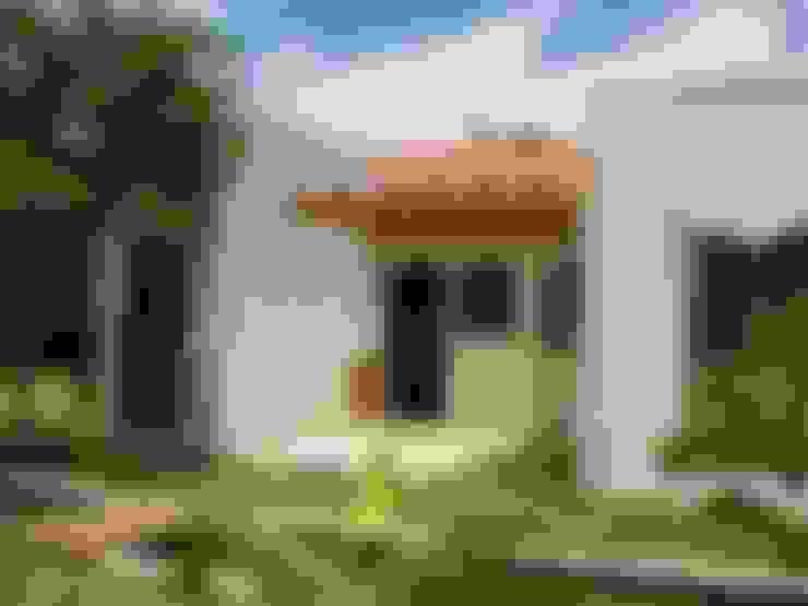 Houses by Mina Arquitetura & Construções