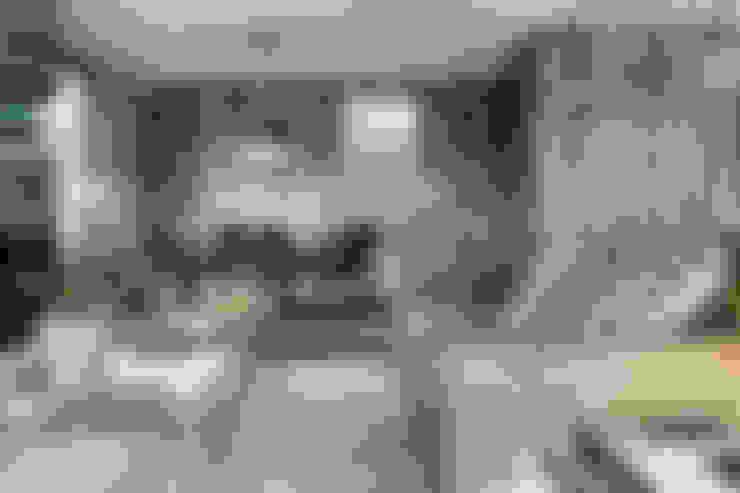 Apartamento Porto: Salas de estar  por Jorge Cassio Dantas Lda