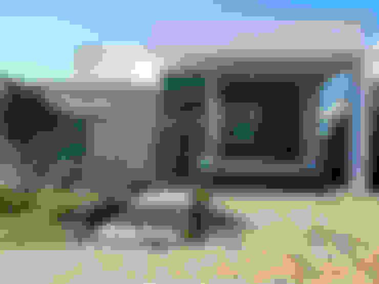 Projekty,  Domy zaprojektowane przez Vieitez Bernils Arquitetos Ltda.