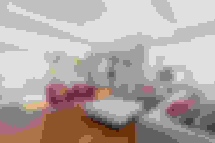Living room by VISMARACORSI ARQUITECTOS