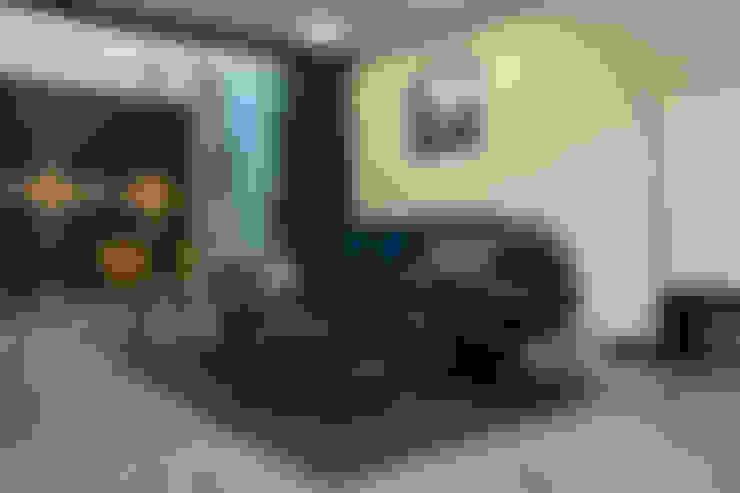 Salas / recibidores de estilo  por INDICO