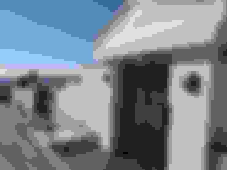 Casas de estilo  por UAArquitectos