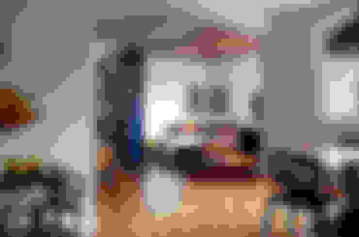 Apartamento Gabriel Monteiro da Silva: Sala de estar  por Bruschini Arquitetura