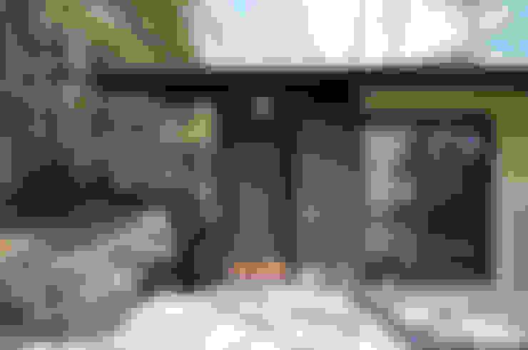 Casas  por モリモトアトリエ / morimoto atelier