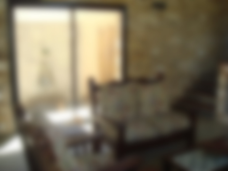 Salas de estar  por Arquitecto Oscar Alvarez