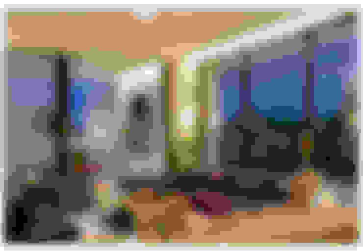 Casa Bulcão: Salas de estar  por ANDRÉ BRANDÃO + MÁRCIA VARIZO arquitetura e interiores