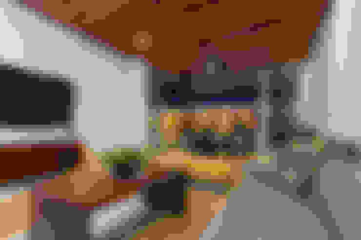 Ampliación Residencia La Rioja: Salas multimedia de estilo  por Grupo Arsciniest