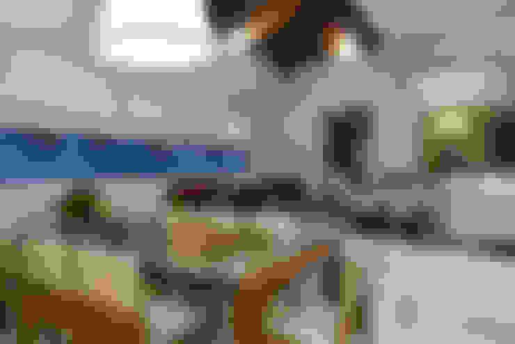 Residência AM: Salas de jantar  por Isabela Canaan Arquitetos e Associados
