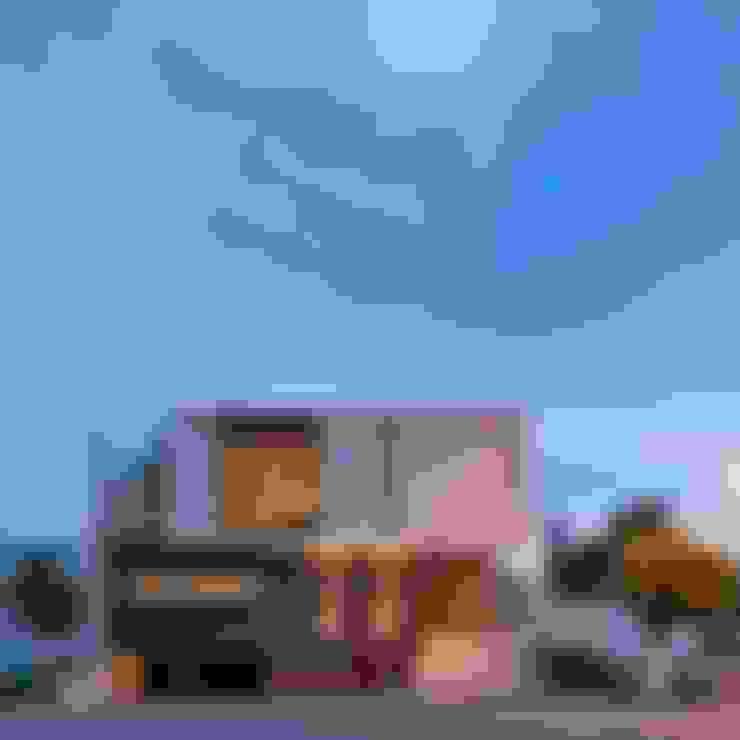 Casa Koz: Casas de estilo  por Tacher Arquitectos