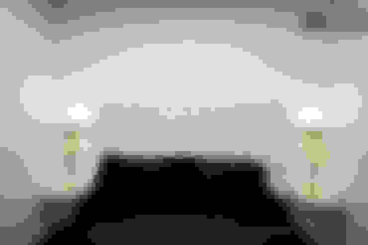 Dormitorios de estilo  por Upper Design by Fernandez Architecture Firm