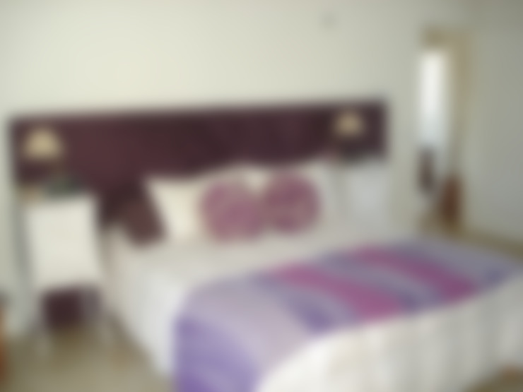 Bedroom by Fainzilber Arqts.