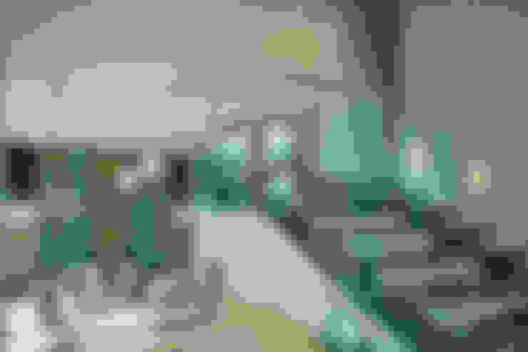 Escaleras de estilo  por AIDA TRACONIS ARQUITECTOS EN MERIDA YUCATAN MEXICO