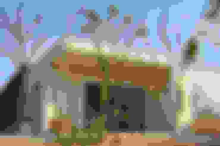 Projekty,  Domy zaprojektowane przez Degetau Arquitectura y Diseño