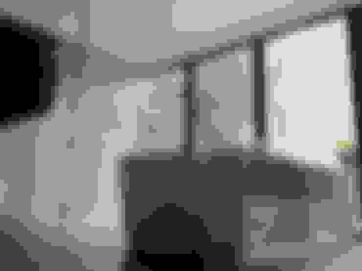 APTO MEJIA - MORA: Baños de estilo  por unouno estudio