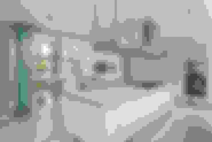 Casa AG: Cocinas de estilo  por oda - oficina de arquitectura
