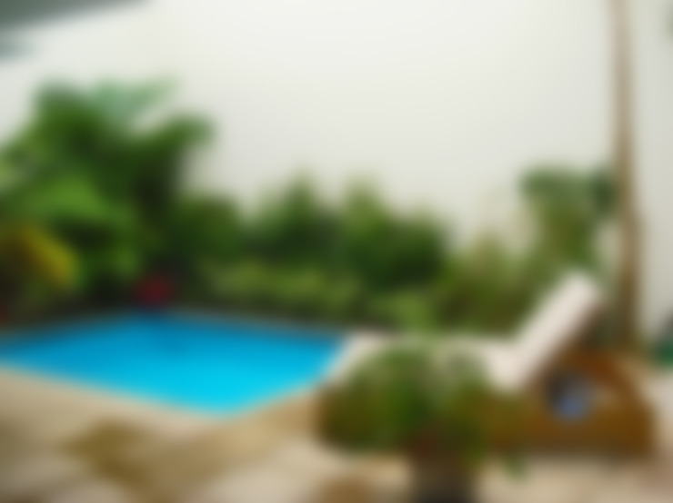 Hồ bơi trong vườn by PORTO Arquitectura + Diseño de Interiores