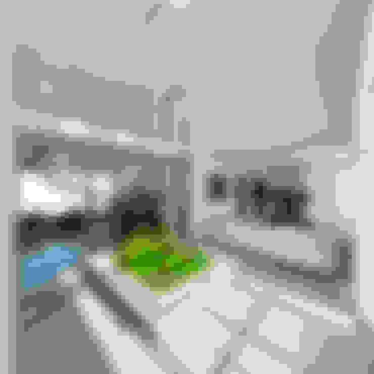 Corredores e halls de entrada  por JRK Diseño - Studio Arquitectura
