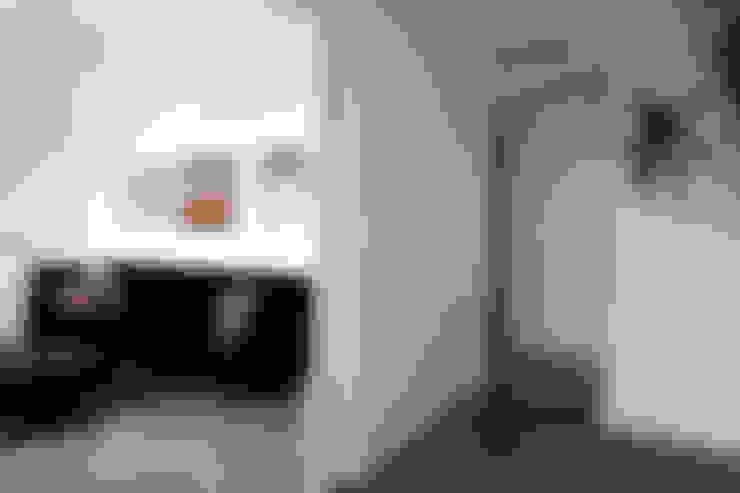 Salas / recibidores de estilo  por Singularq Architecture Lab