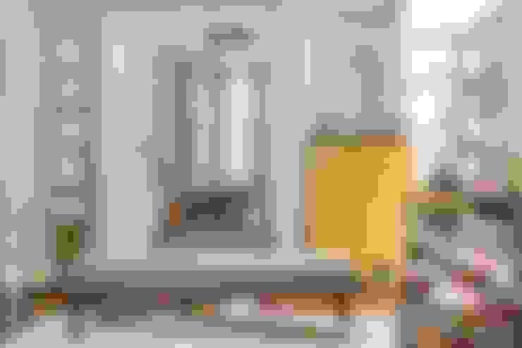 Casa Alto da Boa Vista: Salas de estar  por Alma em Design