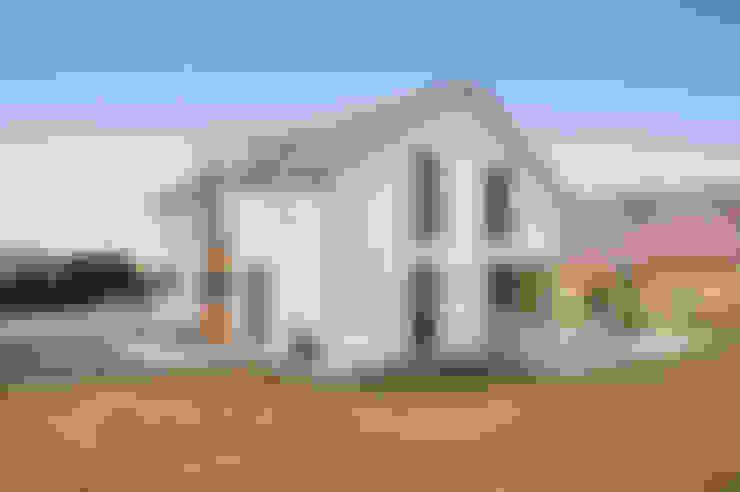 Houses by Hauptvogel & Schütt Planungsgruppe
