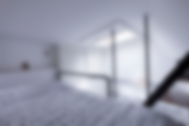 Camera da letto in stile  di 토맥건축사사무소