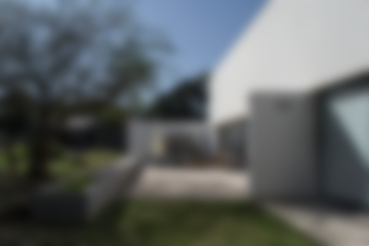 Casa LS: Casas de estilo  por BLTARQ  Barrera-Lozada